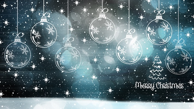 Merry Christmas with back drop of a starry night sky and Christmas baubles