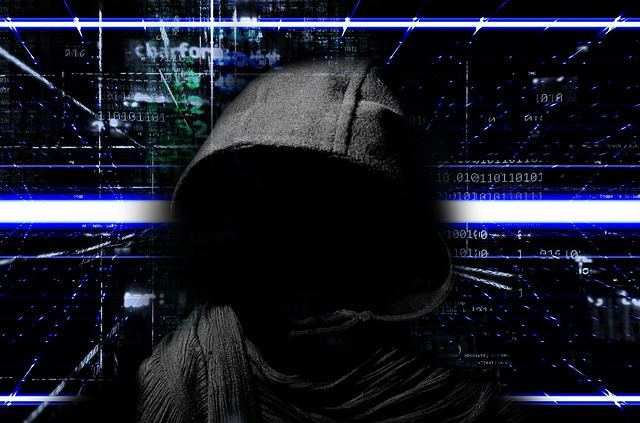 Ominous cyber crime image of grim reaper figure in front of a digital display