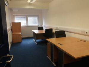 Four person office, with windows, at Weatherill House Business Centre with wooden desks, chairs and filing cabinets