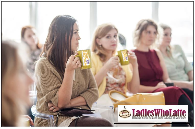 Ladies seated in a row with coffee cups bearing the StartUp Croydon logo. And the Ladies Who Latte is at the bottom of the page
