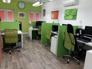 Office 016 at Weatherill House with wood effect flooring and decorated in orange and lime green with white desks
