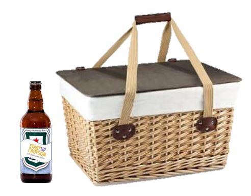 Picnic hamper with a bottle of StartUp Croydon branded beer