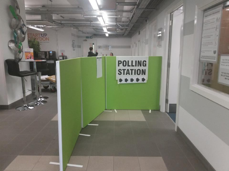 Photo of the polling station set-up inside Weatherill House, directing voters to one of our prestigious business meeting rooms