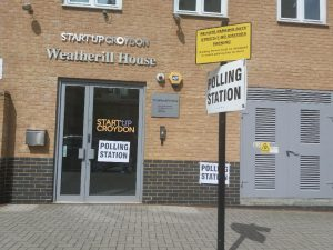 The front of Weatherill House with Polling Station signs