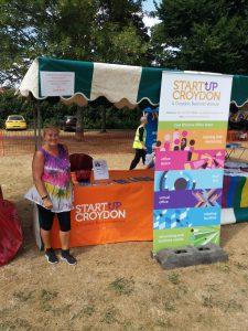 Feyley Barnham, Business Development Exec, in front of the StartUp Croydon stall and Croydon Pridefest 2018