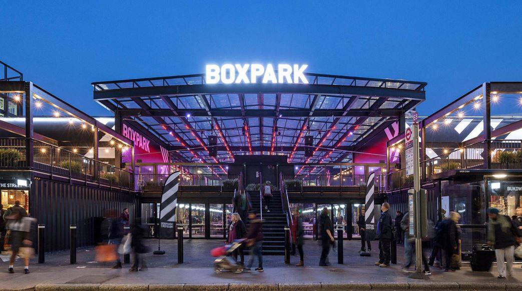 Photo of the front of Croydon BoxPark at night